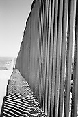 Douglas, Arizona<br /> May 4, 2008<br /> <br /> West of Douglas new border fencing marks the US/Mexican border. The vast majority of the Arizona/Mexican border is now lined with vehicle barrier or high fencing.