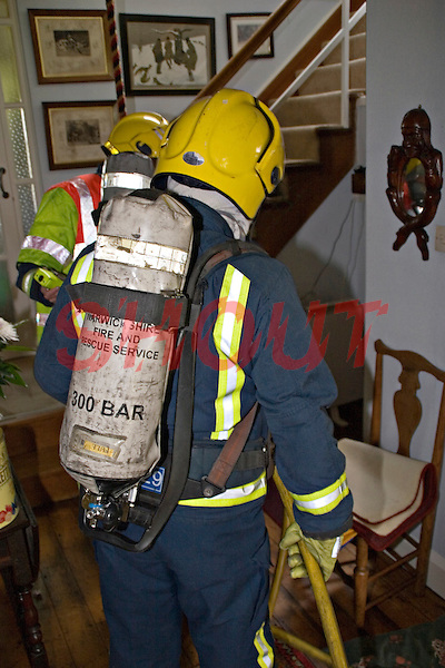 Firefighters wearing Breathing Apparatus enter a home to deal with a severe fire. This image may only be used to portray the subject in a positive manner..©shoutpictures.com..john@shoutpictures.com