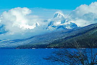 Snow capped mountains surround beautiful McDonald Lake in Glacier National Park