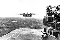 Take off from the deck of the USS HORNET of an Army B-25 on its way to take part in first U.S. air raid on Japan.  Doolittle Raid, April 1942.  (Navy)<br /> Exact Date Shot Unknown<br /> NARA FILE #:  080-G-41196<br /> WAR & CONFLICT BOOK #:  1148