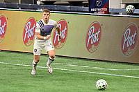ATLANTA, GA - AUGUST 29: Chris Mueller #9 of Orlando City dribbles the ball during a game between Orlando City SC and Atlanta United FC at Marecedes-Benz Stadium on August 29, 2020 in Atlanta, Georgia.