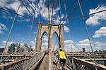 Pedestrians and bicyclists on  Brooklyn Bridge walkway, from Brooklyn to lower Manhattan, New York, New York. .  John offers private photo tours in Denver, Boulder and throughout Colorado. Year-round. .  John offers private photo tours in Denver, Boulder and throughout Colorado. Year-round.