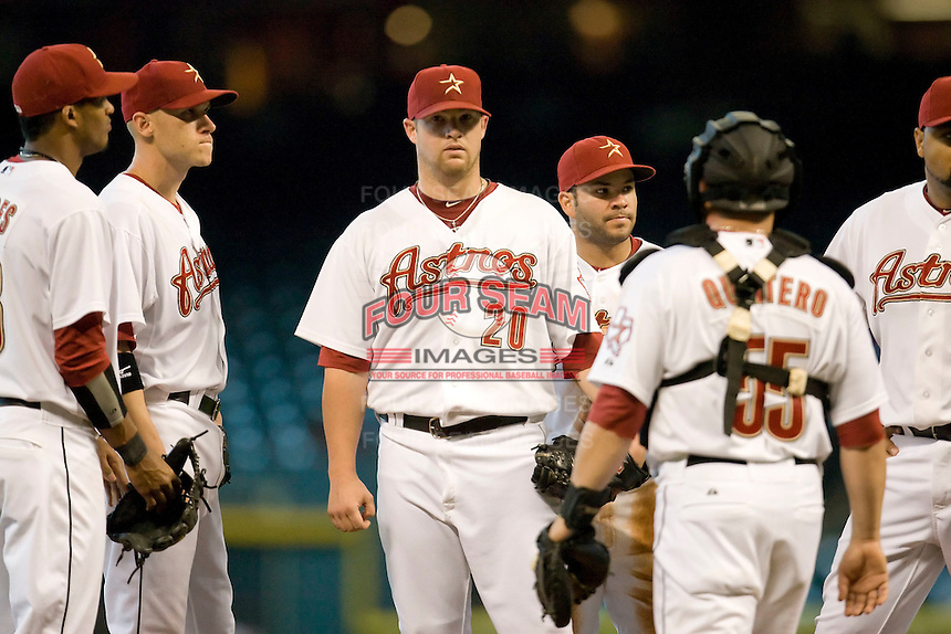 Houston Astros pitcher Bud Norris #20 meets with his infielders during the Major League Baseball game against the Philadelphia Phillies at Minute Maid Park in Houston, Texas on September 14, 2011. Philadelphia defeated Houston 1-0.  (Andrew Woolley/Four Seam Images)
