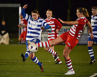 20140221 - OOSTAKKER , BELGIUM : duel pictured between Antwerp Sophie Mannaert (r) and Gent Nina Vindevoghel (l) during the soccer match between the women teams of AA Gent Ladies  and RAFC Antwerp Ladies , on the 19th matchday of the BeNeleague competition Friday 21 February 2014 in Oostakker. PHOTO DAVID CATRY