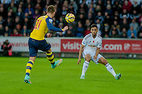 Sunday 9th November 2014<br /> Pictured: Alex Oxlade-Chamberlain of Arsenal kicks the ball past Neil Taylor of Swansea City<br /> Re: Barclays Premier League Swansea City v Arsenal at the Liberty Stadium, Swansea, Wales,UK