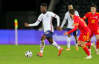 SWANSEA, WALES - NOVEMBER 12: Yunus Musah #18 of the United States moving with the ball during a game between Wales and USMNT at Liberty Stadium on November 12, 2020 in Swansea, Wales.