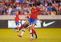 HOUSTON, TX - FEBRUARY 03: Maria Paula Salas #17 of Costa Rica battles with Carli Loyd #10 of the United States during a game between Costa Rica and USWNT at BBVA Stadium on February 03, 2020 in Houston, Texas.