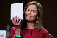 United States Supreme Court justice nominee Amy Coney Barrett holds up her notepad at the request of US Senator John Cornyn (Republican of Texas), on the second day of her Senate Judiciary Committee confirmation hearing in Hart Senate Office Building on Tuesday, October 13, 2020. <br /> CAP/MPI/RS<br /> ©RS/MPI/Capital Pictures
