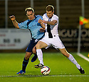 Forfar's Iain Campbell and Ayr Utd's Craig Malcolm challenge for the ball.