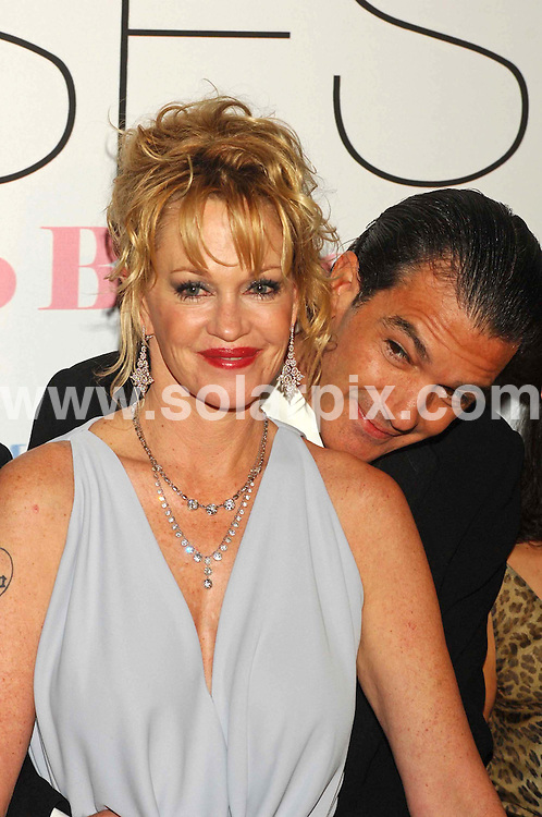 """**ALL ROUND PICTURES FROM SOLARPIX.COM**.SYNDICATION RIGHTS FOR UK, CANADA, USA, SOUTH AFRICA, SOUTH AMERICA, DUBAI, AUSTRALIA, NEW ZEALAND, GREECE, ASIA.30-11-06 .Antonio Banderas and Melanie Griffith, in Madrid, at Kinepolis Cinema, for the premiére of his latest film, """"El Camino de los Ingleses"""". (The English Way).JOB REF: 3125   SPA.**MUST CREDIT SOLARPIX.COM OR DOUBLE FEE WILL BE CHARGED**"""