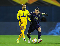18th March 2021; Zagreb, Croatia;  Arijan Ademi of Dinamo Zagreb goes past Lucas Moura of Tottenham Hotspur during the UEFA Europa League Round of 16 Second Leg match between Dinamo Zagreb and Tottenham Hotspur at Maksimir stadium