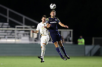 CARY, NC - AUGUST 01: Robert Kristo #11 heads the ball over Jake Rufe #13 during a game between Birmingham Legion FC and North Carolina FC at Sahlen's Stadium at WakeMed Soccer Park on August 01, 2020 in Cary, North Carolina.