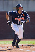 Tyler Cannon #10 of the Virginia Cavaliers hustles down the first base line versus the East Carolina Pirates at Clark-LeClair Stadium on February 20, 2010 in Greenville, North Carolina.   Photo by Brian Westerholt / Four Seam Images