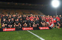 The teams pose for a group photo after the Steinlager Series rugby match between the New Zealand All Blacks and Tonga at Mt Smart Stadium in Auckland, New Zealand on Saturday, 3 July 2021. Photo: Dave Lintott / lintottphoto.co.nz