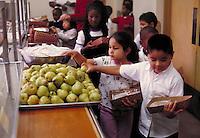 ELEMENTARY SCHOOL LUNCH LINE IN CAFETERIA. ELEMENTARY SCHOOL STUDENTS. OAKLAND CALIFORNIA USA CARL MUNCK ELEMENTARY SCHOOL.