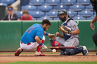 Clearwater Threshers Arturo De Freitas (12) is hit in the head by a pitch in front of catcher Charles Mack (33) during a game against the Fort Myers Mighty Mussels on July 29, 2021 at BayCare Ballpark in Clearwater, Florida.  (Mike Janes/Four Seam Images)