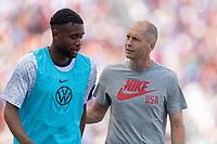 SANDY, UT - JUNE 10: Gregg Berhalter speaks to Jordan Siebatcheu during a game between Costa Rica and USMNT at Rio Tinto Stadium on June 10, 2021 in Sandy, Utah.