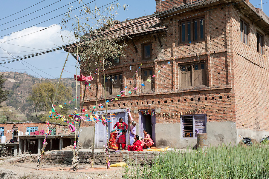 Bhaktapur, Nepal.  Women Relaxing Outside their House, Decorated for a Wedding Celebration.