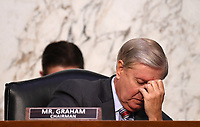 United States Senator Lindsey Graham (Republican of South  Carolina), Chairman, US Senate Judiciary Committee, pauses during a US Senate Judiciary Committee confirmation hearing on the nomination of Amy Coney Barrett for Associate Justice of the Supreme Court, on Capitol Hill in Washington, DC on Thursday, October 15, 2020.  If confirmed, Barrett will replace Justice Ruth Bader Ginsburg, who died last month. <br /> Credit: Kevin Dietsch / Pool via CNP /MediaPunch