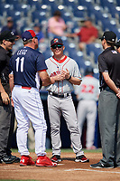 Portland Sea Dogs manager Darren Fenster (23) meets with manager Gregg Legg (11), home plate umpire Derek Thomas, third base umpire Chris Marco and 1B umpire Derek Gonzales prior to the first game of a doubleheader against the Reading Fightin Phils on May 15, 2018 at FirstEnergy Stadium in Reading, Pennsylvania.  Portland defeated Reading 8-4.  (Mike Janes/Four Seam Images)