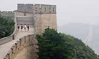 USWNT teammates Heather Mitts, Rachel Buehler, Stephanie Cox, and Carli Lloyd  walk away from a tower while climbing the Great Wall at Badaling near Beijing, China.  The team is spending a few days in Beijing before moving to Qinhuangdao to prepare for their first two group games of the 2008 Olympics.