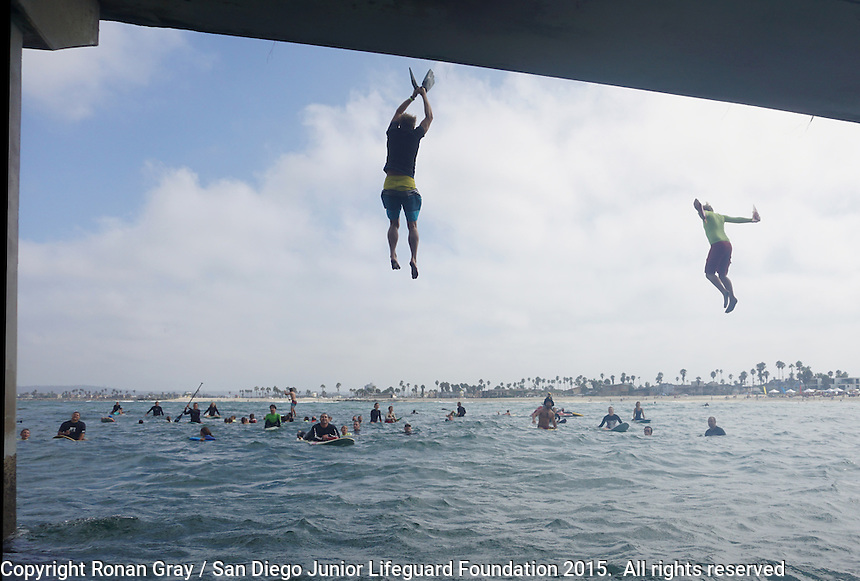 August 17 2015, Ocean Beach San Diego CA USA: San Diego Junior Lifeguards and some brave parents prove their courage with a giant leap from the Ocean Beach Pier into the turbulent waters below.  The twice annual San Diego tradition is the culmination of weeks of training by the young guards, aged 9 to 16 years old.