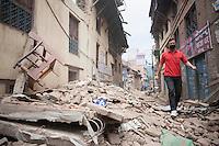 A man walks in a street full with rubble in Shanku near Kathmandu, Nepal.  . May 9, 2015