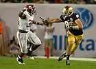 Jan. 7, 2013; Notre Dame tight end Tyler Eifert pushes past Alabama linebacker Nico Johnson during the third quarter of the 2013 BCS National Championship in Miami, Florida. Photo by Barbara Johnston/University of Notre Dame