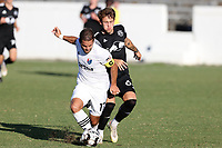RICHMOND, VA - SEPTEMBER 30: Ben Speas #17 of North Carolina FC is fouled by Jake LaCava #64 of New York Red Bulls II during a game between North Carolina FC and New York Red Bulls II at City Stadium on September 30, 2020 in Richmond, Virginia.