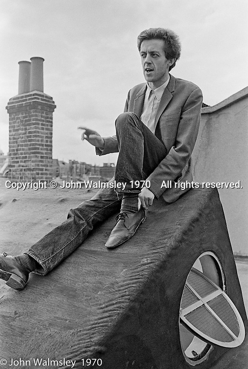 Cornelius Cardew (1936-1981), avant-garde musician and composer, outside his favourite cafe, Fitzrovia, London.  3rd July 1970.