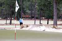 PINEHURST, NC - MARCH 02: Eric Bae of Wake Forest University chips out of a bunker and onto the green on the 17th hole at Pinehurst No. 2 on March 02, 2021 in Pinehurst, North Carolina.