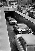 Voitures quittant le stationnement souterrain de la tour de la Bourse, Place Victoria, Octobre 1979<br /> <br /> PHOTO : JJ Raudsepp  - Agence Quebec presse