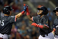 Reading Fightin Phils Cornelius Randolph (2) high fives Jose Gomez (15) after hitting a home run that would be overturned by the field umpire during an Eastern League game against the Trenton Thunder on August 16, 2019 at FirstEnergy Stadium in Reading, Pennsylvania.  Trenton defeated Reading 7-5.  (Mike Janes/Four Seam Images)