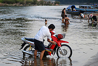 LAO PDR, Muang Khua at Nam Ou river , a branch of Mekong river , washing of Honda scooter