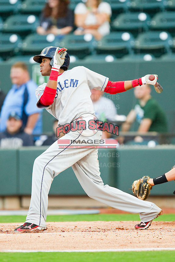 Michael Almanzar #5 of the Salem Red Sox follows through on his swing against the Winston-Salem Dash at BB&T Ballpark on May 5, 2012 in Winston-Salem, North Carolina.  The Red Sox defeated the Dash 6-4.  (Brian Westerholt/Four Seam Images)