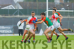 David Mangan Mid Kerry  holds up Shane McSweeney Kilcummin during their SFC clash in Fitzgerald Stadium on Saturday