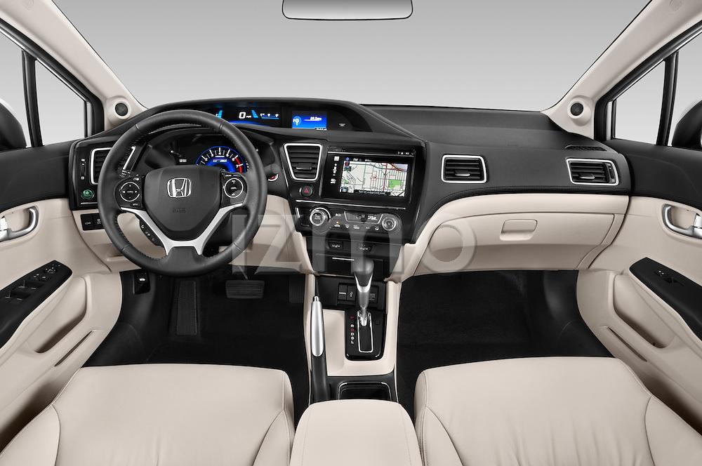 Stock photo of straight dashboard view of a 2014 Honda Civic Hybrid Hybrid CVT 4 Door Sedan Dashboard