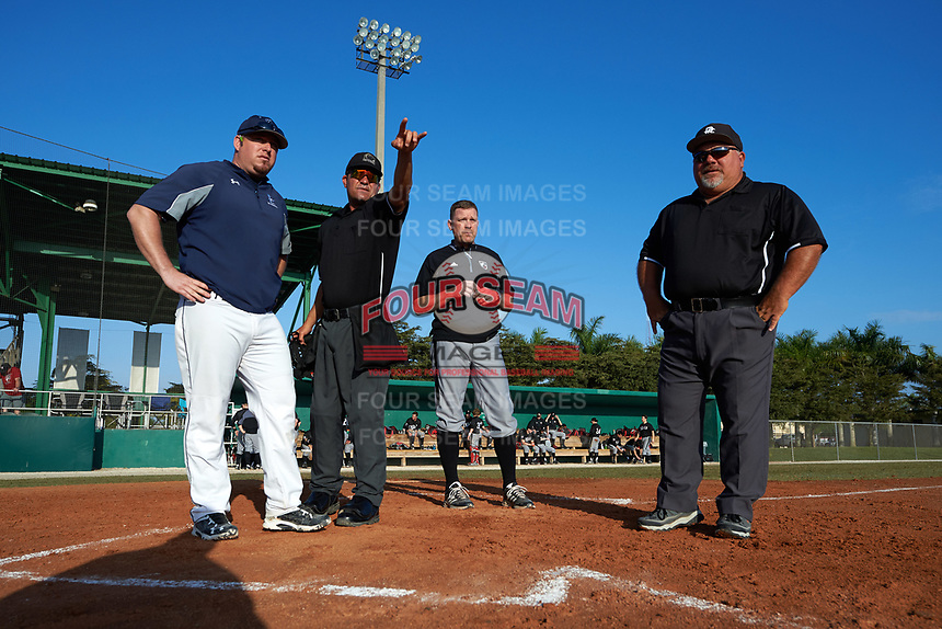 Edgewood Eagles head coach Al Brisack and Lasell Lasers head coach Greg Harjula go over the ground rules with the umpires before a game on April 14, 2016 at Terry Park in Fort Myers, Florida.  Edgewood defeated Lasell 9-7.  (Mike Janes/Four Seam Images)