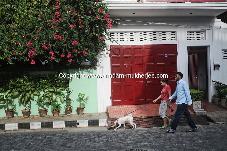 A western girl with his Indian Friend. Local people mix up quite well with the French residents in Pondicherry. Arindam Mukherjee.