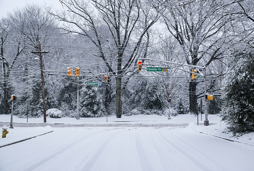 Snow covered road and traffic light.
