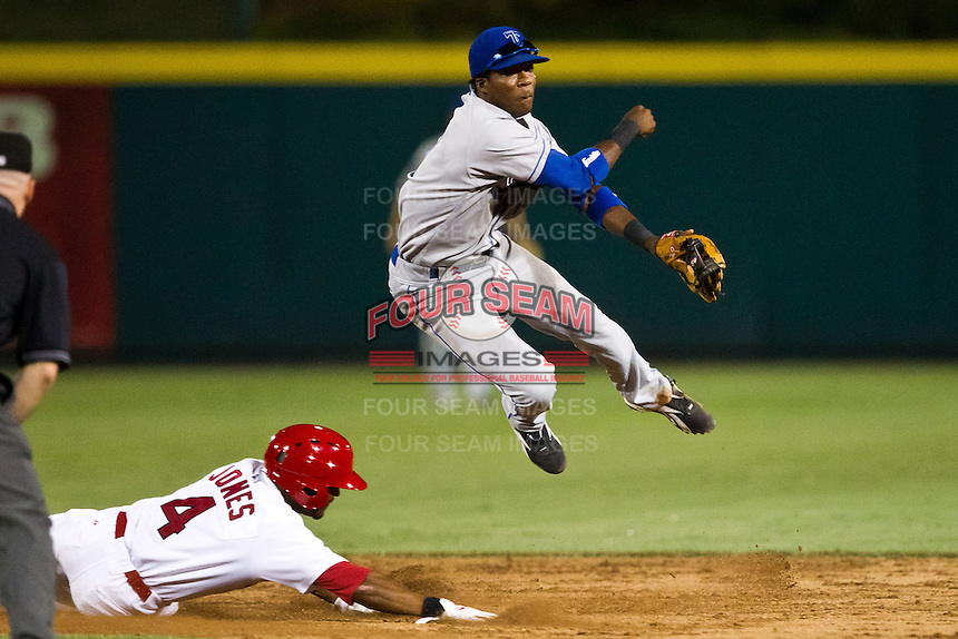 Hector Gomez (5) of the Tulsa Drillers turns a double play during a game against the Springfield Cardinals at Hammons Field on July 18, 2011 in Springfield, Missouri. Tulsa defeated Springfield 13-8. (David Welker / Four Seam Images)