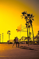 Basketball  game with guys on beach at sunset near Venice Beach in Los Angeles Californi