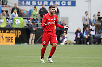 SEATTLE, WA - NOVEMBER 10: Alejandro Pozuelo #10 of Toronto FC complains to the referee during a game between Toronto FC and Seattle Sounders FC at CenturyLink Field on November 10, 2019 in Seattle, Washington.