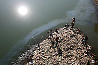 Young boys fish in Jehlum River (or Jhelum River). The river is polluted. Srinagar, Kashmir, India. © Fredrik Naumann/Felix Features