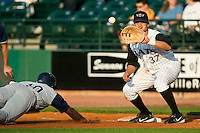 Charlotte second baseman Jason Bourgeois (10) dives back to first base as Louisville's Jesse Gutierrez (37) waits for the throw at Louisville Slugger Field in Louisville, KY, Tuesday, June 5, 2007.