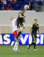 Rich Balchan (2) of the Columbus Crew goes up for the ball with Joel Lindpere (20) of the New York Red Bulls during the game at Red Bull Arena in Harrison, NJ.  The New York Red Bulls tied the Columbus Crew, 1-1.