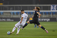 SAN JOSE, CA - SEPTEMBER 13: Sebastian Lletget #17 of the L.A. Galaxy and Florian Jungwirth #23 of the San Jose Earthquakes battle for the ball during a game between Los Angeles Galaxy and San Jose Earthquakes at Earthquakes Stadium on September 13, 2020 in San Jose, California.