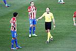 Spanish referee Antonio Miguel Mateu Lahoz show yellow card to Atletico de Madrid's Stefan Savic during La Liga match. February 26,2017. (ALTERPHOTOS/Acero)