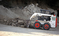 Pictured: A mini digger spreads soil so that specialist search officers go through it by the farmhouse where Ben Needham disappeared from in Kos, Greece. Monday 10 October 2016<br />Re: Police teams led by South Yorkshire Police are searching for missing toddler Ben Needham on the Greek island of Kos.<br />Ben, from Sheffield, was 21 months old when he disappeared on 24 July 1991 during a family holiday.<br />Digging has begun at a new site after a fresh line of inquiry suggested he could have been crushed by a digger.