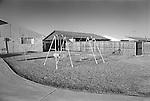Dallas, Texas neighborhood backyard with swing set. 1975